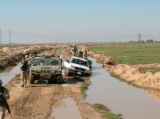 Combat wasn't the only danger in Iraq. Accidents accounted for many, many American and Iraqi lives. While this incident was nothing more than a gigantic pain in the ass, such rollovers and submersions could be deadly. Heavy vehicles would collapse the farm roads, rolling over into a water filled ditched. The vehicle would sink into the mud. Encased, unable to open the vehicle doors and hatches, the crew would slowly drown to death. The other members of the patrol would be unable to dig out the vehicle and would have to wait helplessly for a recovery team while their mates died.
